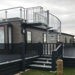 Sky deck, with grey ballustrade, grey glass with grey deck boards