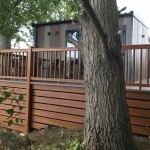 Golden oark ballustrade with brown deck boards and golden oak ranch style skirting