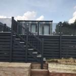 Grey ballustrade, grey glass with grey deck boards